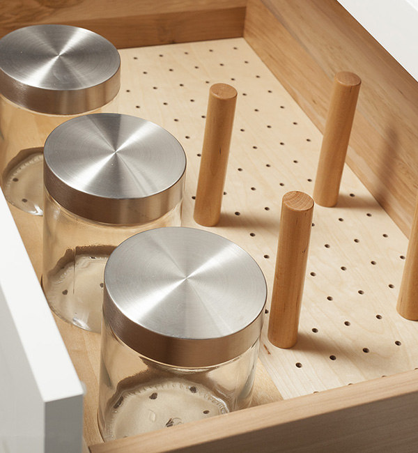 Pegboard Organizer With Round Pegs And Glass Storage Containers